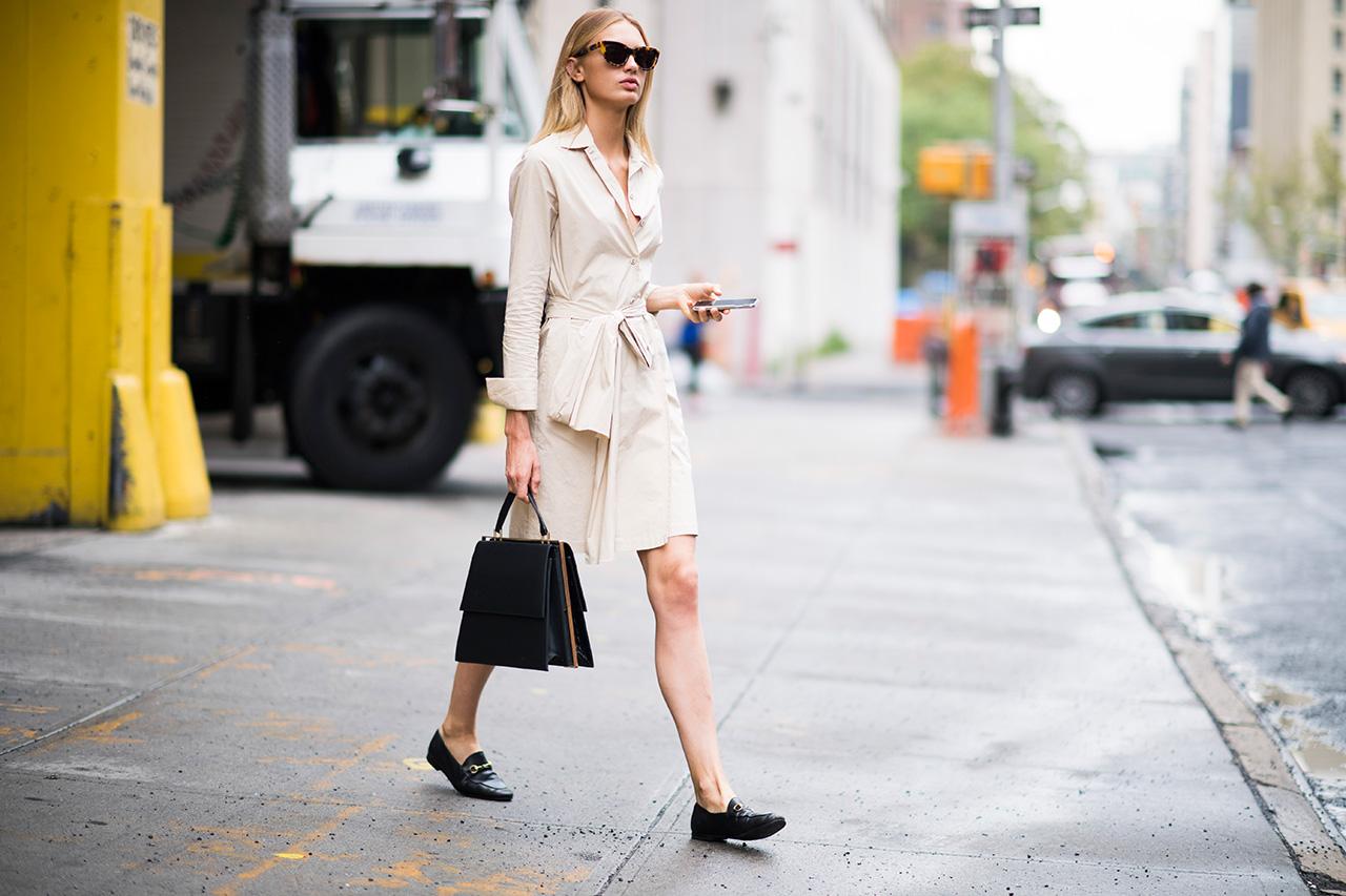 Woman walking on the pavement wearing flat shoes