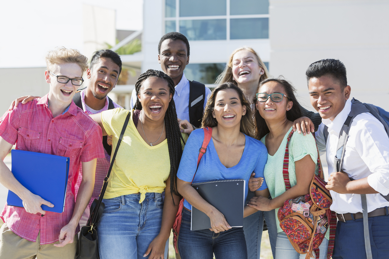 Multi-ethnic group of teenagers at school, outdoors