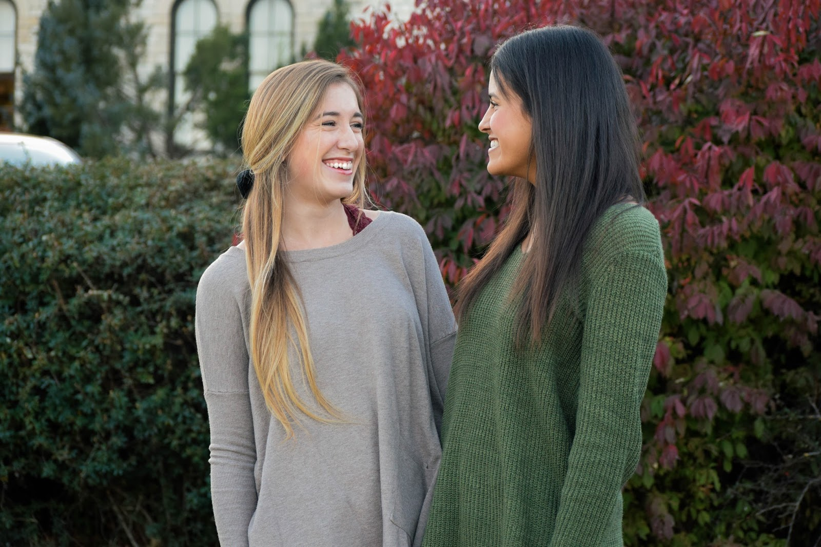 Two women smiling at each other, one younger than the other