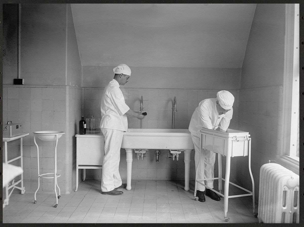 Vintage photo of doctors washing their hands