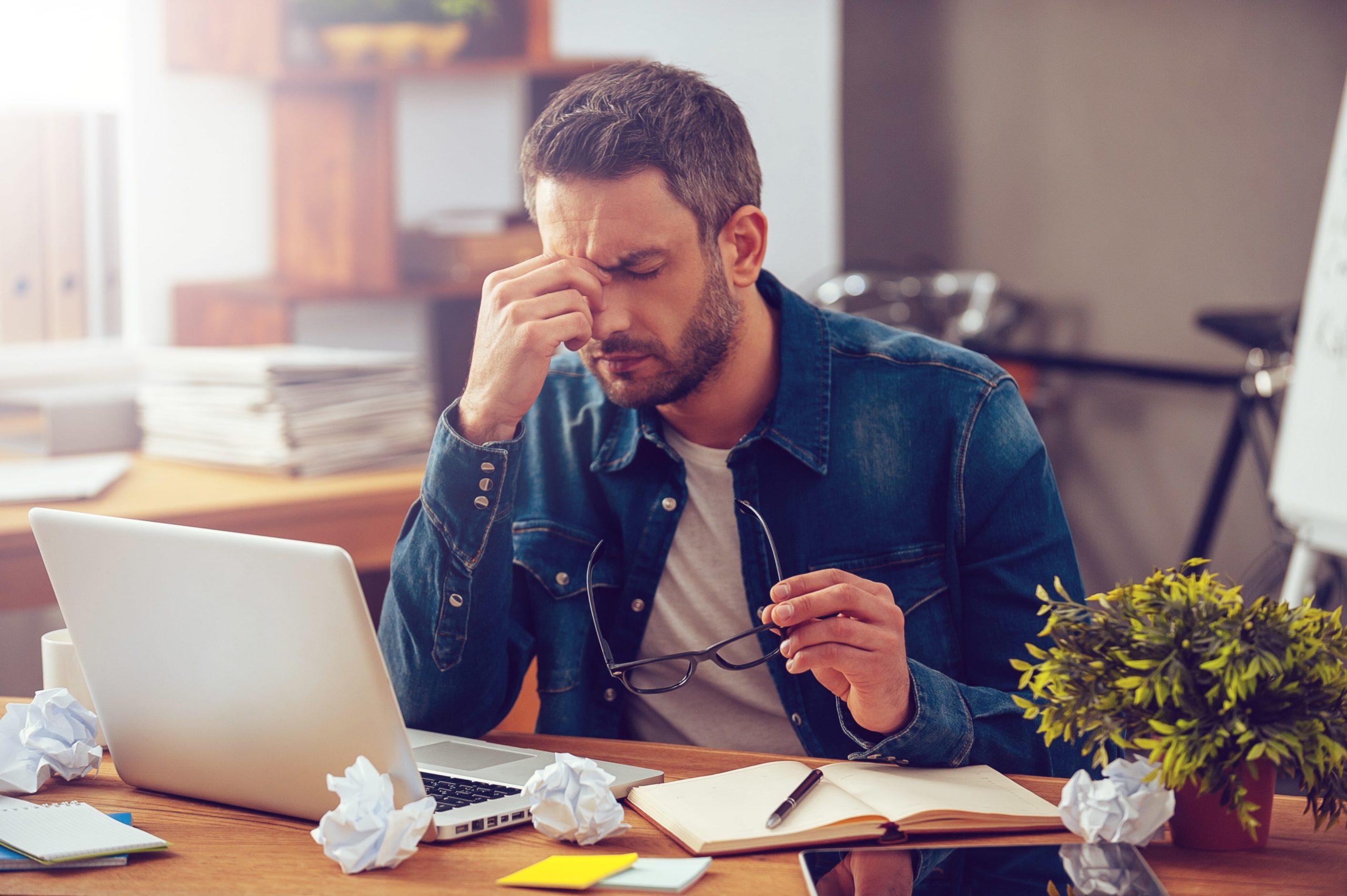 Man having trouble focusing while at work
