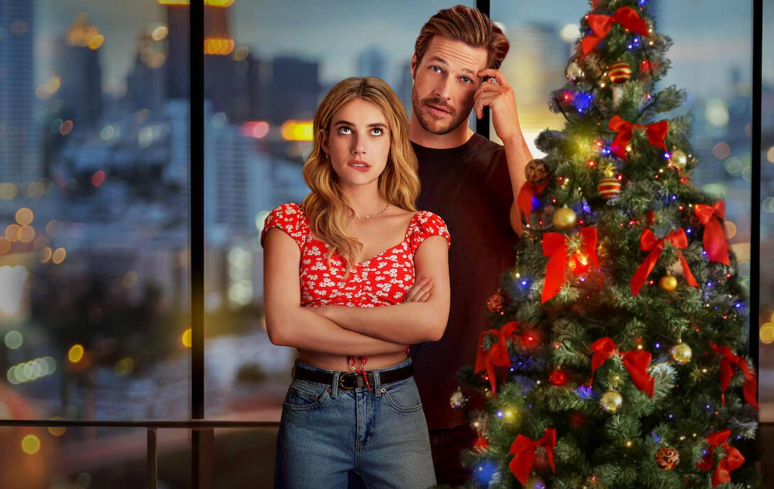 Emma Roberts and Luke Bracey in the Holidate poster
