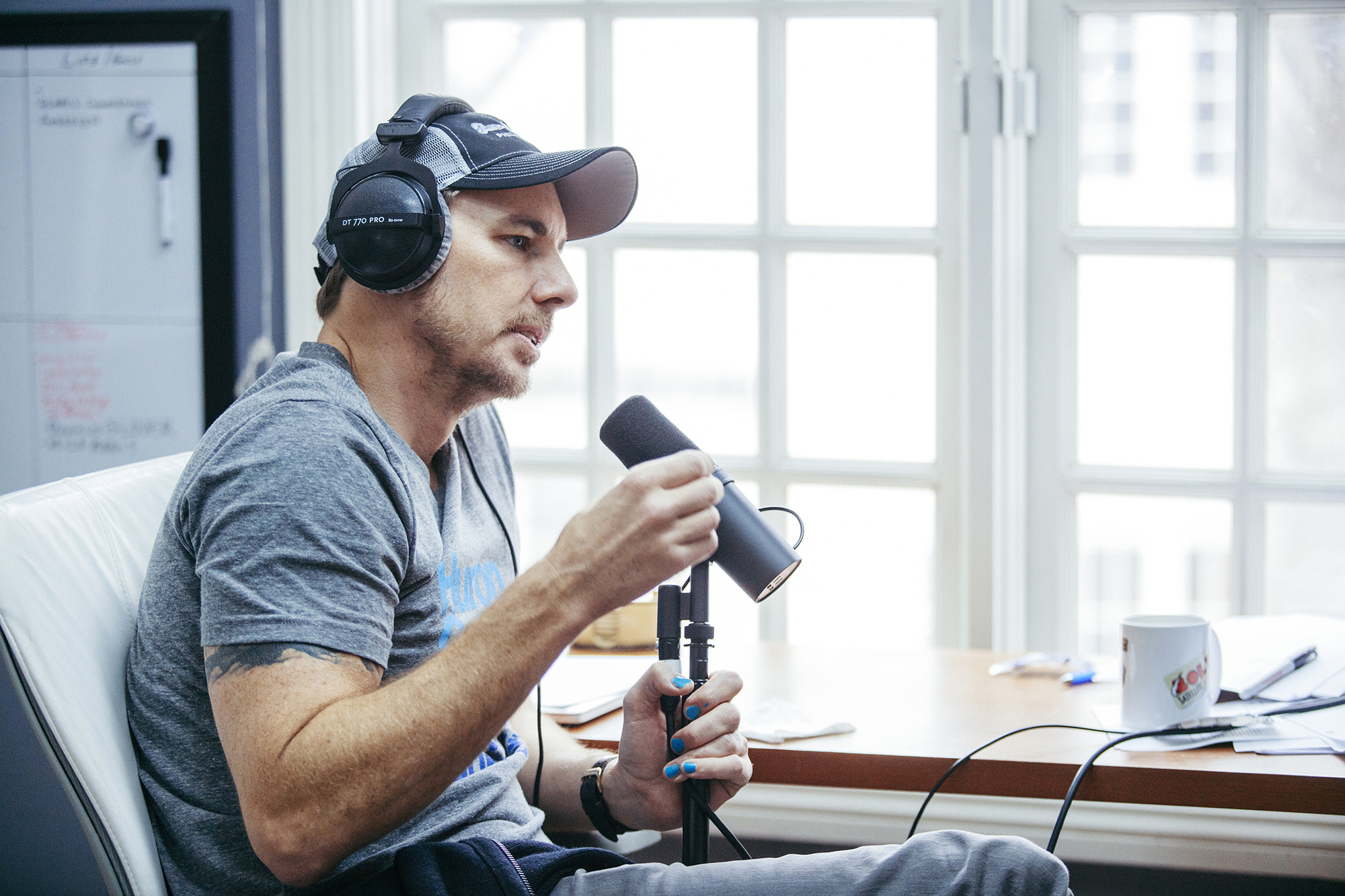 Dax Shepard while hosting his podcast, Armchair Expert