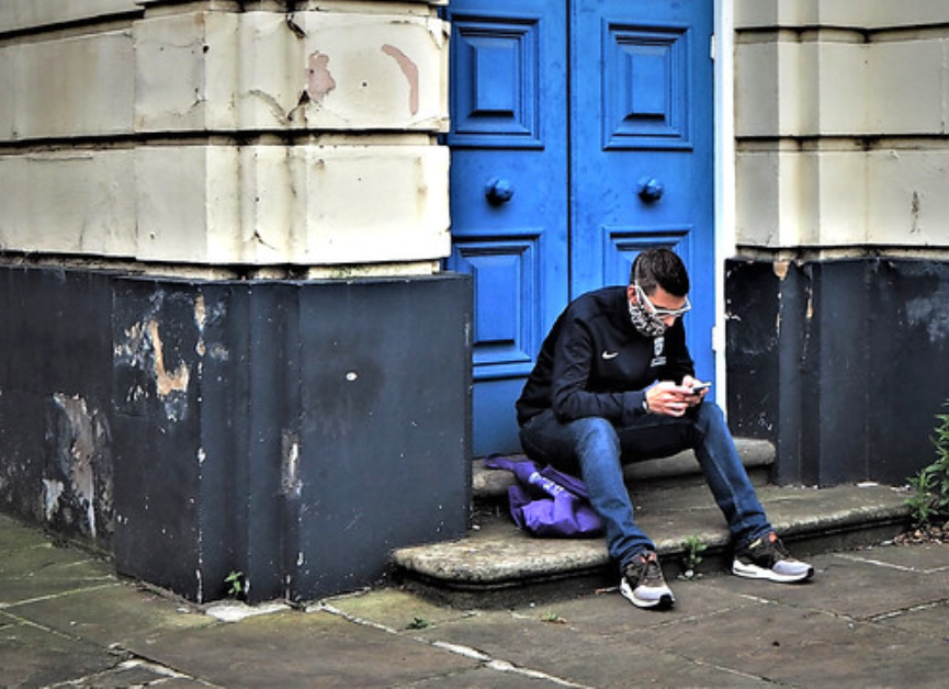 Waiting at the doorstep, texting