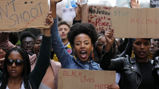 Demonstrators from the Black Lives Matter movement from which woke emerged.