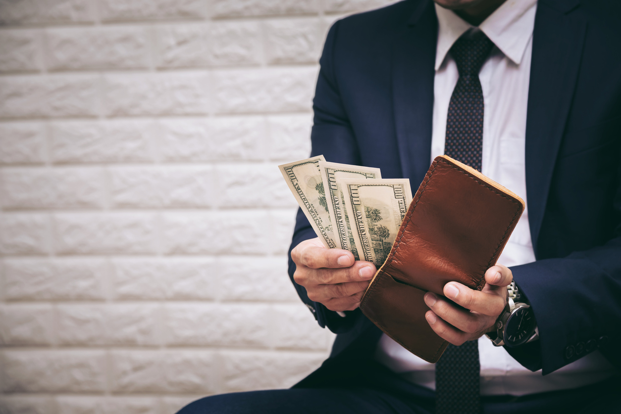 Businessman Having Dollar Money Banknotes in Leather Wallet - Finance and Business Concept