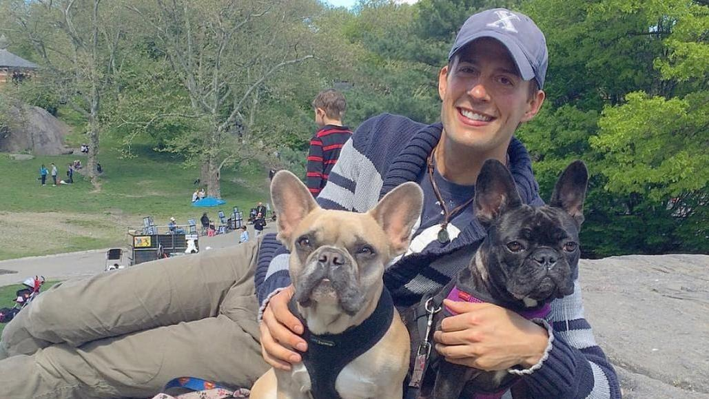 Ryan Fischer, Lady Gaga's dogwalker, poses with the pop singer's dogs.