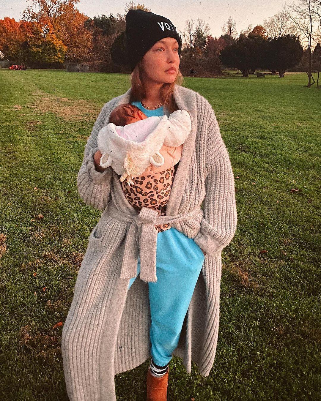 Gigi Hadid holding her newborn baby