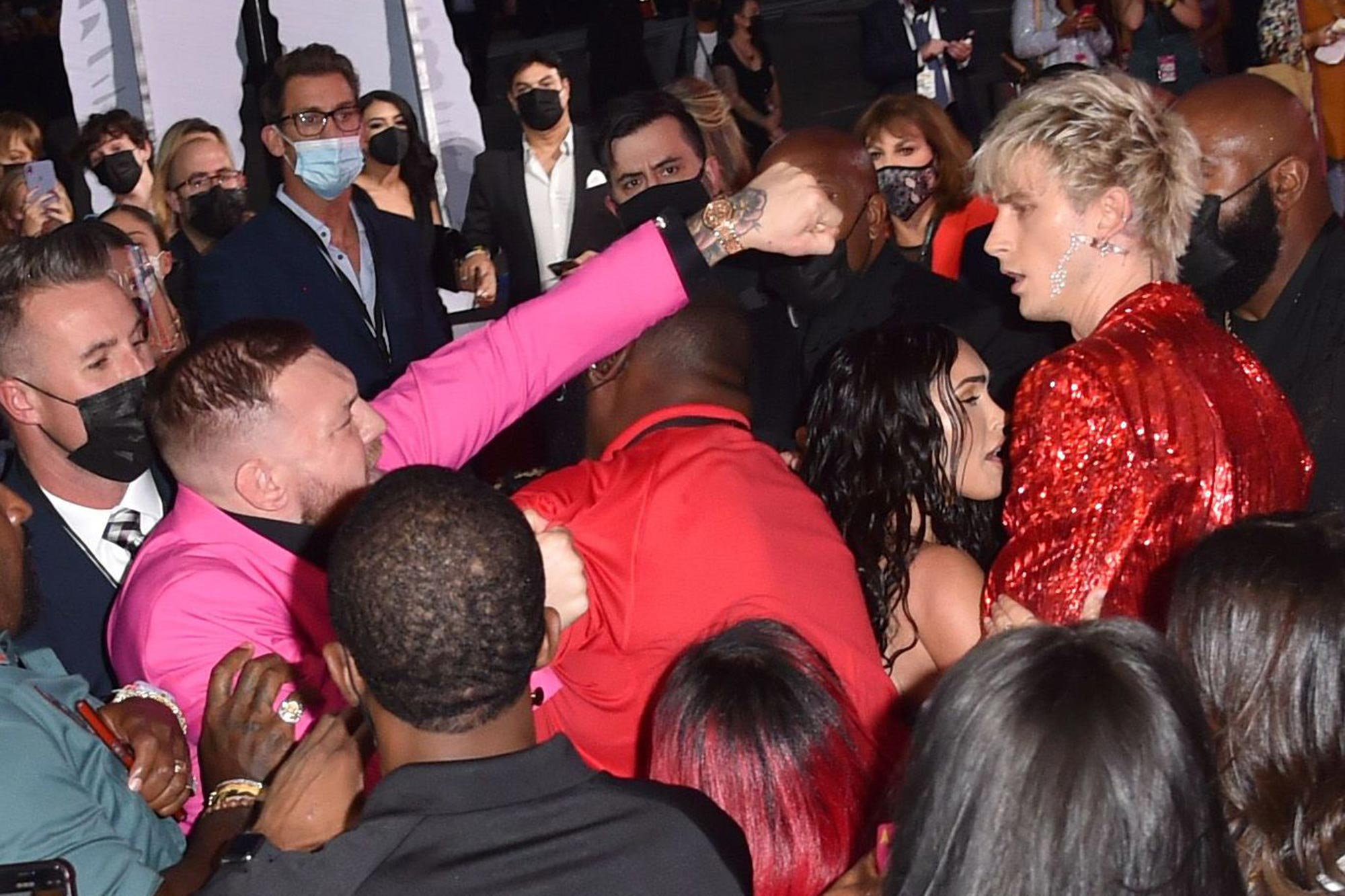 Conor McGregor Swinging at Machine Gun Kelly on the VMA's red carpet.