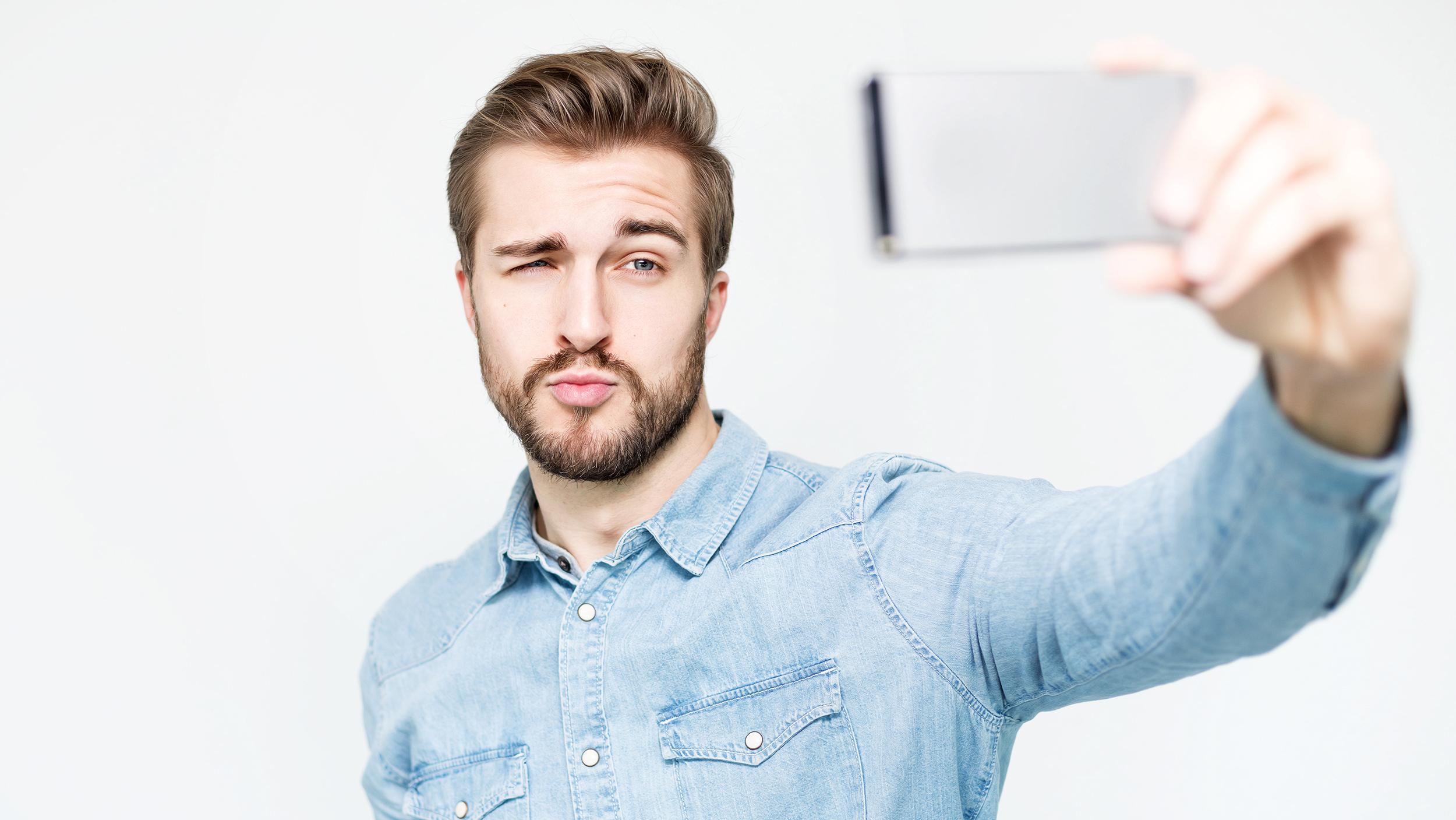 A guy taking a selfie